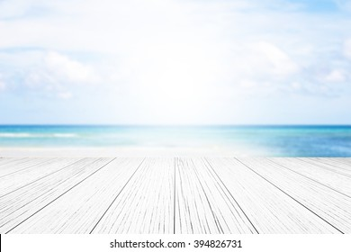 wood floor background blurred ocean beach abstract style.Light center of the image concept, ideas differ.