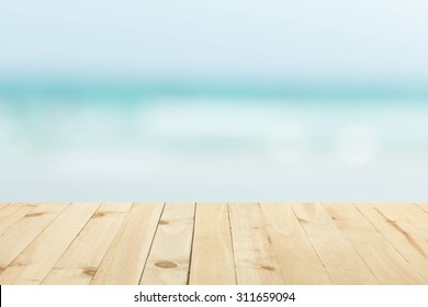 wood floor with blurred sea background.