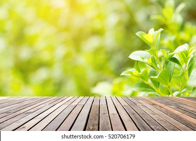 wood floor with fresh leaves background