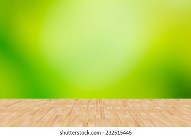 Wood floor with green abstract blurred background