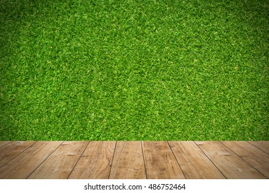 wood floor with green grass background.