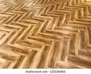 Wood floor material background. Laminate wood floor . The floor of the light brown laminate diagonally