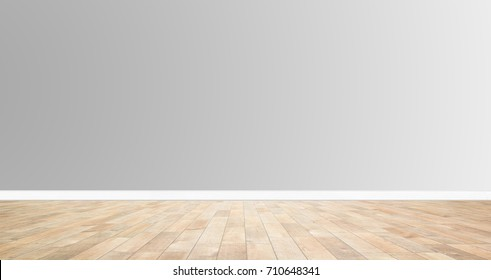 Wood floor on grey wall background. For montage or display products