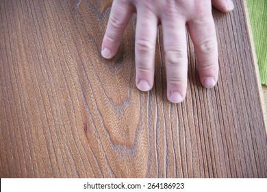 wood floor parquet shop selecting variants hands closeup