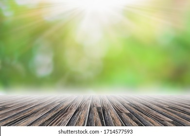 Wood floor scene backdrop Green bokeh blur with sun beam
