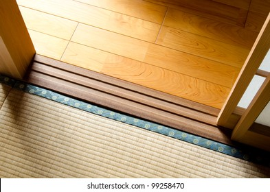 Wood floor and straw mat divided with paper sliding door