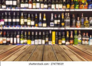 wood floor and wine Liquor bottle on shelf - Blurred background