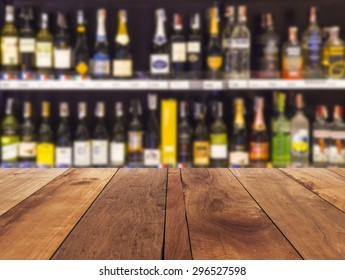 wood floor and wine Liquor bottle on shelf - Blurred background