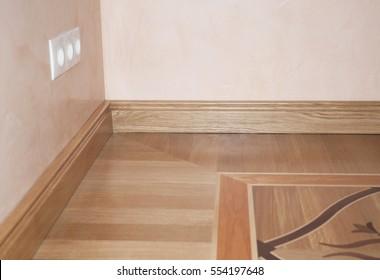 Wood Flooring. Skirting Board Oak Wooden Floor . Flooring with Wooden Batten Repair.