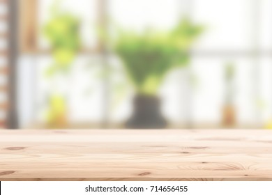 Wood foreground with blur interior green plant at home concept background design for display nature products