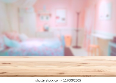 Wood foreground with blur pink lovely bedroom blur background for display products