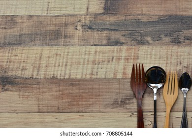 Wood fork, Spoon, Soup Spoon Bottom right corner of the frame on brown wood texture for background. Copy space