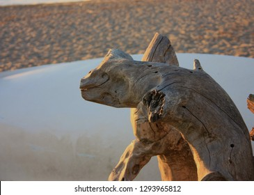 wood found at the sea, worked and polished by the salt water force. the shape is strange, grotesque, that of a gollum, of trolls, of gargoyles