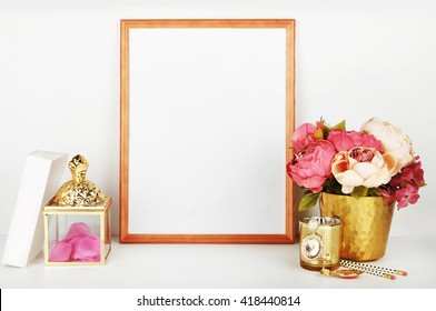Wood frame with gold vase and gold items. Frame mock-up.