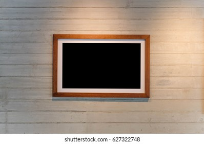 Wood frame on white wall