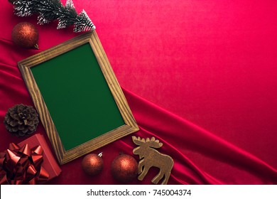 wood frame with xmas tree and decor on red fabric ground