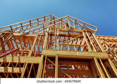 wood framework of new residential home under construction. Home Under Construction