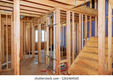 Wood framing work in progress with wood framing walls and ceiling or floor joist on new construction building