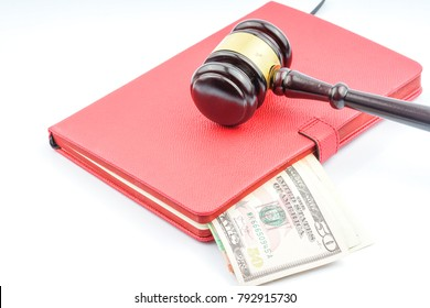 Wood gavel hammer and usd banknote with corruption concept.