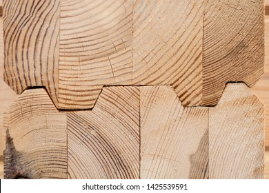 Wood Glued timber close up. Wooden grain timber end background. Glued pine timber beams. Wood for building a house. Building materials made of wood. Glued beams. Wooden beams in the groove.