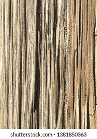 Wood grain texture from old worn weathered utility pole