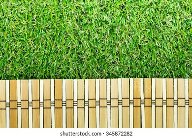 wood and Green grass background texture.