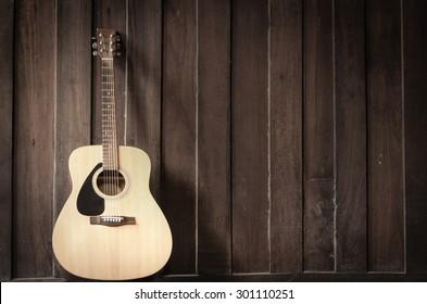 Wood guitar against wall
