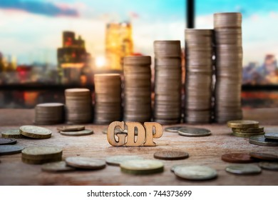 Wood with heap and stack of Coins for Business and Finance Concept