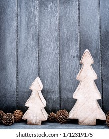 Wood holiday decorations and pine cones with copy space   with dark wood background