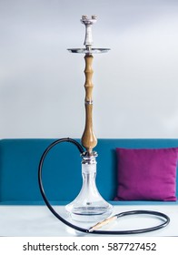 Wood hookah on table in hookah lounge