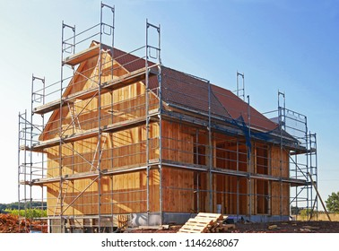 wood house in construction, blue sky