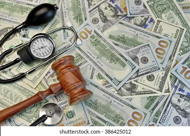 Wood Judges Gavel And Medical Tools On The Dollar Cash Background, Overhead View, Concept For Medical Negligence, Bail, Monetary Compensation, Bad  Treatment