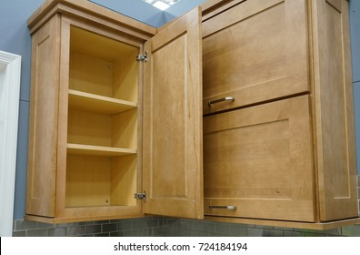 Wood kitchen cabinet with door open