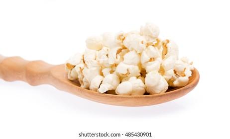 wood ladle of Pop corn isolated on white background.
