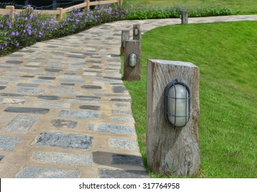 Wood lamp pole in the garden