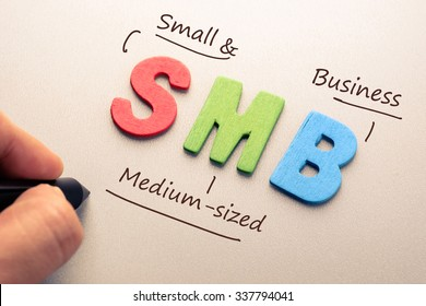 Wood letter of SMB abbreviation with hand writing definition