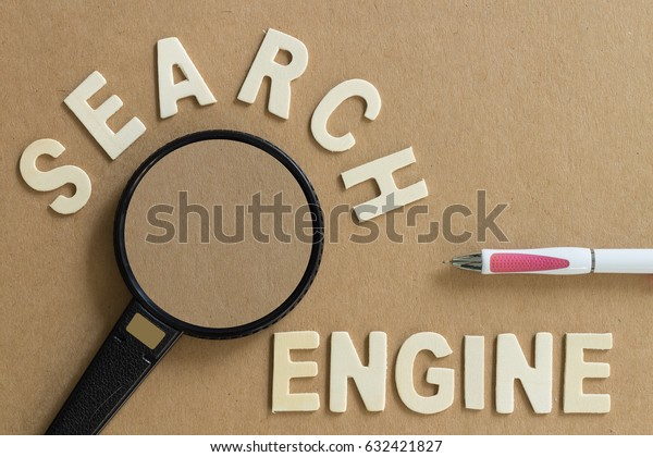 Wood Letters Arranged Search Engine Magnifying Stock Photo