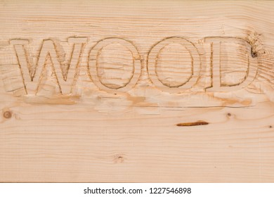 wood letters carved into the wood desk