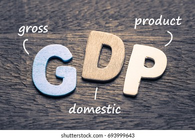 Wood letters of GDP and definition on wood background