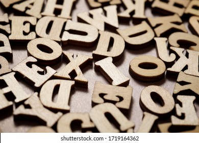 Wood letters on a table.