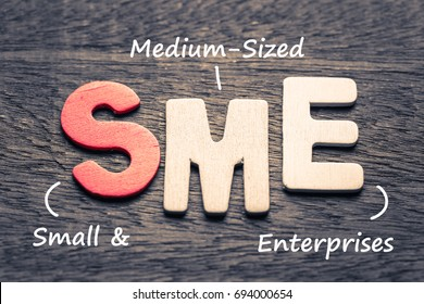 Wood letters of SME and definition on wood background