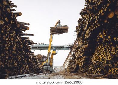 wood lift crane factory cut log storage tree