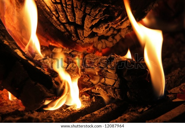 Wood logs as being burnt in a fireplace