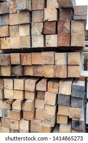 wood lumbers square front views texture stockpiled in warehouse