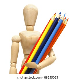 A wood mannequin holds a pencil crayons for the artist.