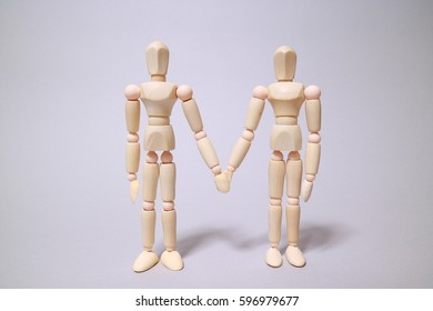 Wood mannequins on gray background To put a shoulder