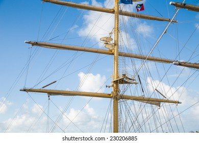 Wood masts of an old clipper ship against a nice sky