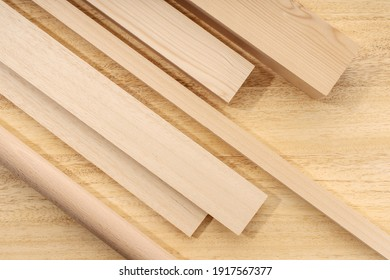 Wood material background  Group of assorted wooden planks, squares, sheets on table  Timber for carpentry  Top view