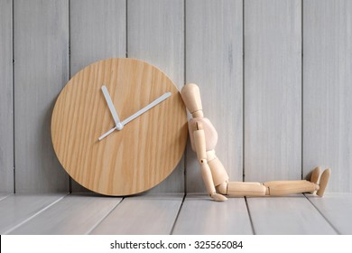 Wood model waiting time with clock, Time concept