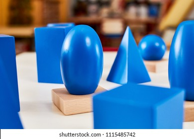 Wood Montessori geometrical solid volumes